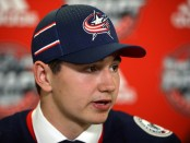 Hockey player Alexandre Texier being interviewed by the media after being drafted in the 2017 NHL Draft