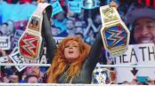 Wrestler Becky Lynch celebrates with both Women's Championships