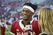 Former Oklahoma Sooners quarterback Kyler Murray speaks to the media after a game against the Baylor Bears