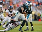 Denver Broncos cornerback Chris Harris, Jr. attempts to tackle Cam Newton against the Carolina Panthers in Super Bowl 50