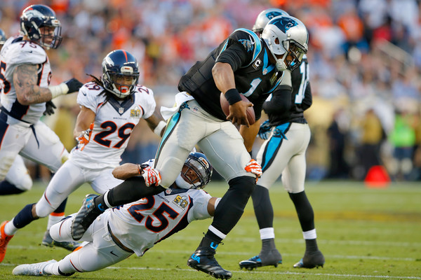 Denver Broncos cornerback Chris Harris, Jr. attempts to tackle Cam Newton against the Carolina Panthers in Super Bowl 50