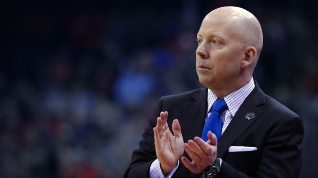 Former Cincinnati Bearcats men's basketball coach Mick Cronin on the sidelines during a college basketball game