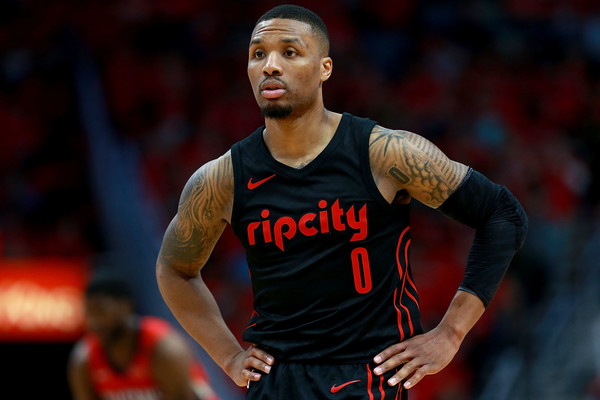 Portland Trail Blazers point guard Damian Lillard stands on the court as his team trails against the New Orleans Pelicans