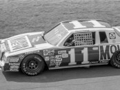 Former NASCAR driver Darrell Waltrip drives the No. 11 Buick Regal during the Firecracker 400
