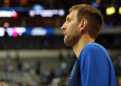 Dallas Mavericks legend Dirk Nowitzki walks off the court in a preseason game against the Beijing Ducks