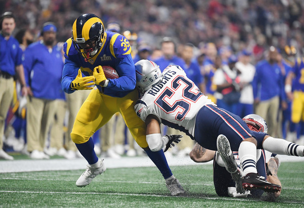Former Los Angeles Rams running back C.J. Anderson runs the ball against the New England Patriots in Super Bowl LIII