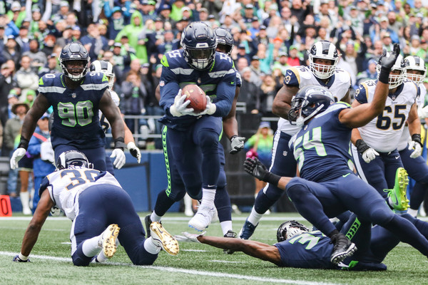 Seattle Seahawks defensive end Frank Clark intercepts a pass against the Los Angeles Rams