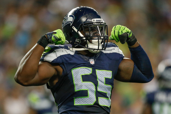 Former Seattle Seahawks defensive end Frank Clark reacts after making a stop against the Minnesota Vikings