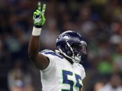 Former Seattle Seahawks defensive end Frank Clark reacts with a peace sign after sacking Drew Brees against the New Orleans Saints