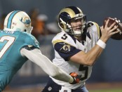 Former St. Louis Rams quarterback Garrett Gilbert scrambles on a play against the Miami Dolphins