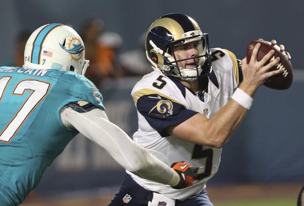 Former St. Louis Rams quarterback Garrett Gilbert scrambles on a play against the Miami Dolphins