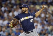 Former Milwaukee Brewers pitcher Gio González pitches during the 2018 NLCS against the Los Angeles Dodgers