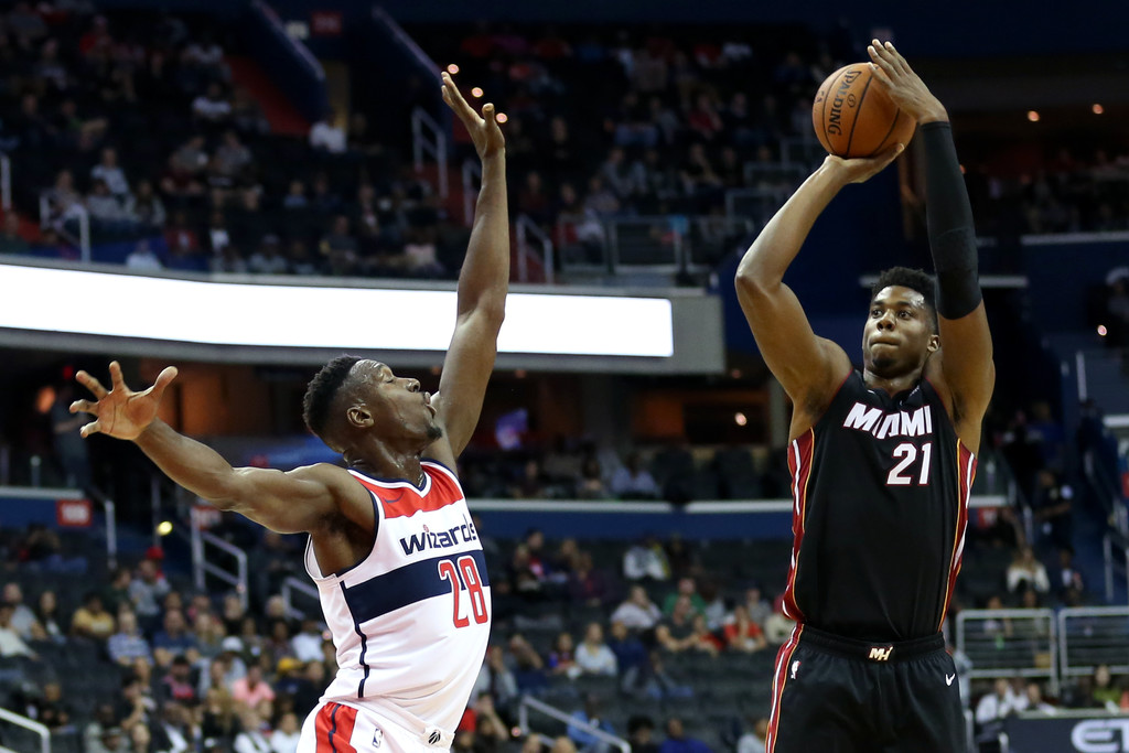 Miami Heat center Hassan Whiteside attempts a shot over Ian Mahinmi against the Washington Wizards