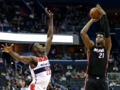 Miami Heat center Hassan Whiteside attempts a shot over Ian Mahinmi against the Washington Wizards