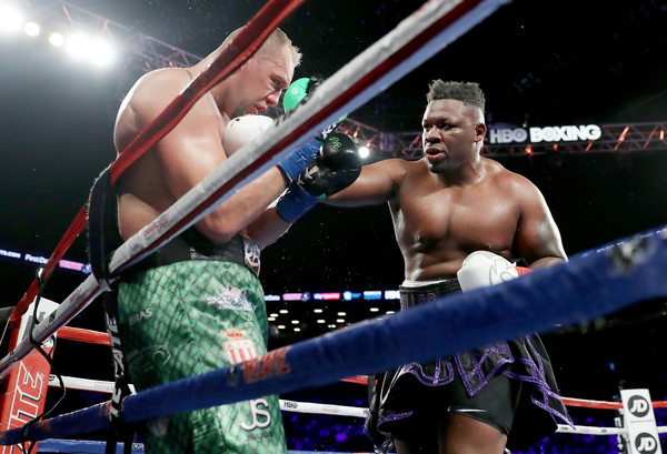 Heavyweight boxer Jarrell Miller exchanges punches with Johann Duhaupas during their WBA Heavyweight match