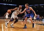 Former Brooklyn Nets guard Jerry Stackhouse dribbles the ball against Steve Novak against the New York Knicks
