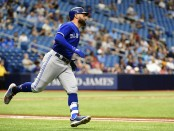 Former Toronto Blue Jays outfielder Kevin Pillar hits a single against the Tampa Bay Rays