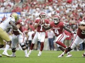 Former Oklahoma Sooners quarterback Kyler Murray attempting a pass against the UCLA Bruins