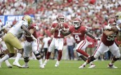 Former Oklahoma Sooners quarterback Kyler Murray looks to make a pass against the UCLA Bruins