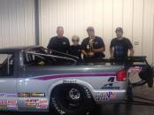 Drag racer Larry Larson with the NHRA Wally after winning the Topeka national event