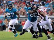 Jacksonville Jaguars running back Leonard Fournette rushing the ball against the Atlanta Falcons