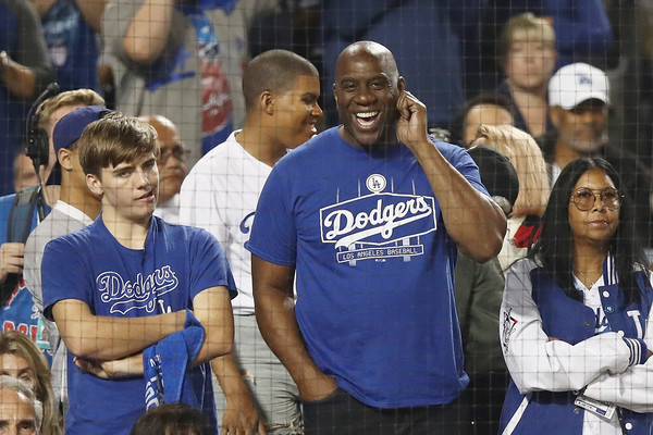 Los Angeles Dodgers owner and former Los Angeles Lakers executive Magic Johnson looks on during the eleventh inning at the 2018 World Series between the Los Angeles Dodgers and the Boston Red Sox