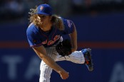 New York Mets pitcher Noah Syndergaard pitching against the Miami Marlins