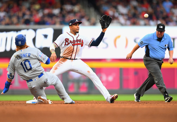 Atlanta Braves second baseman Ozzie Albies makes a force out against the Los Angeles Dodgers in the 2018 MLB playoffs