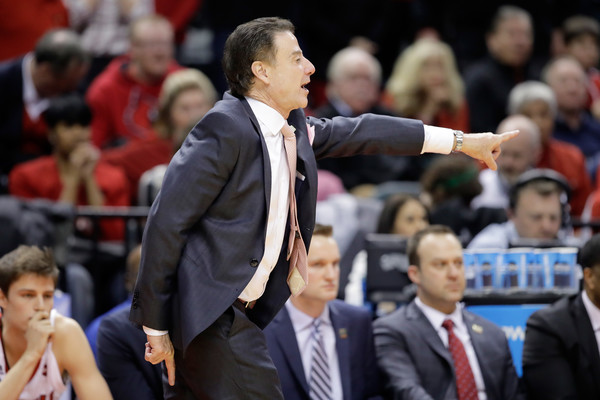 Former Louisville Cardinals head coach Rick Pitino shouts out instructions against the Jacksonville State Gamecocks