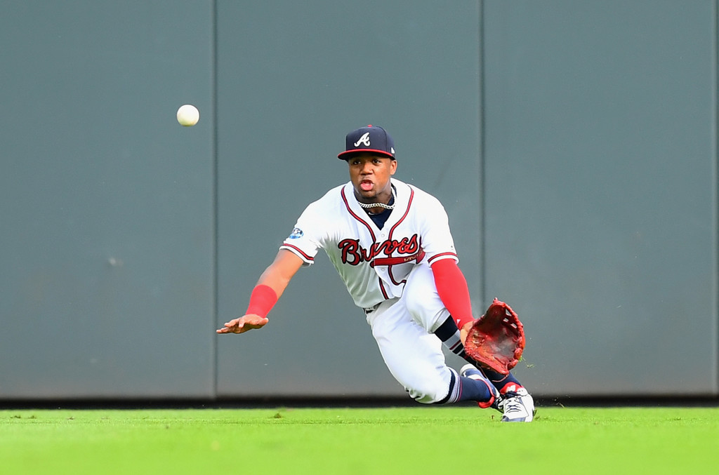 Atlanta Braves outfielder Ronald Acuña Jr. attempts to make a catch against the Los Angeles Dodgers in the 2018 NLDS