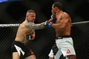 MMA fighter Ross Pearson strikes Francisco Trinaldo at UFC Fight Night 81