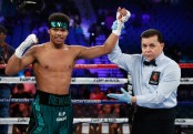 Boxer Shakur Stevenson gets his arm raised following his win over Aelio Mesquita by TKO