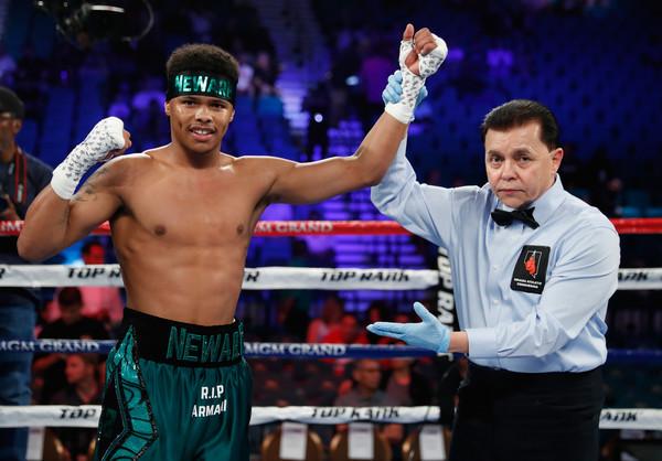 Boxer Shakur Stevenson gets his arm raised following his win overAelio Mesquita by TKO