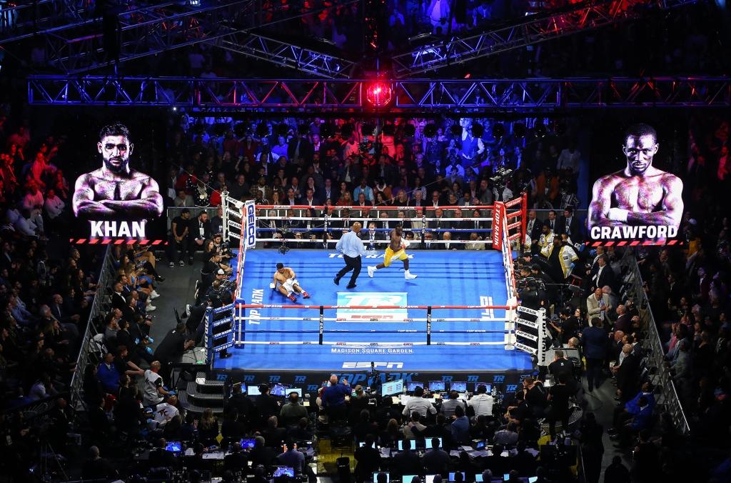 Boxer Terence Crawford backs away following after knocking Amir Khan down