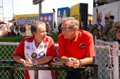The late Terry Chandler talking to Don Schumacher Racing owner Don Schumacher at an NHRA event