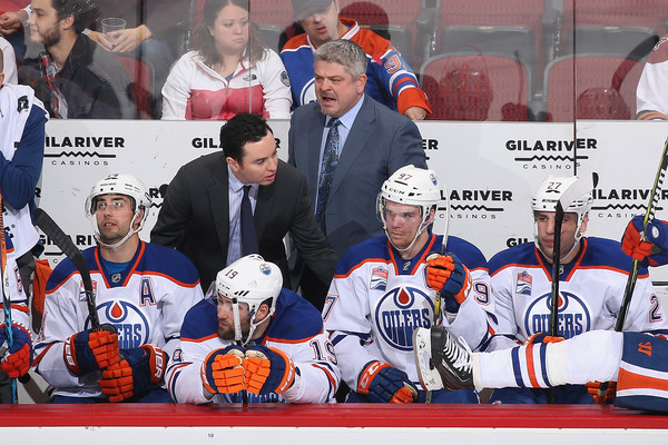 Former Edmonton Oilers head coach Todd McLellan reacts on the bench against the Arizona Coyotes