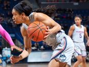 Former Connecticut Huskies guard Mikayla Coombs playing against the Memphis Tigers