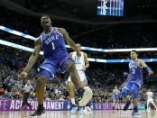Former Duke Blue Devils forward Zion Williamson reacts after a dunk against the North Carolina Tar Heels