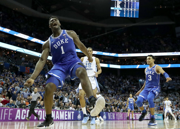 Former Duke Blue Devils forward Zion Williamson reacts after a dunk against the North Carolina Tar Heels