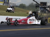Top Fuel Dragster pilot Clay Millican racing on Friday at the Virginia NHRA Nationals
