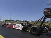 Top Fuel Dragster pilot Clay Millican racing on Saturday at the Virginia NHRA Nationals