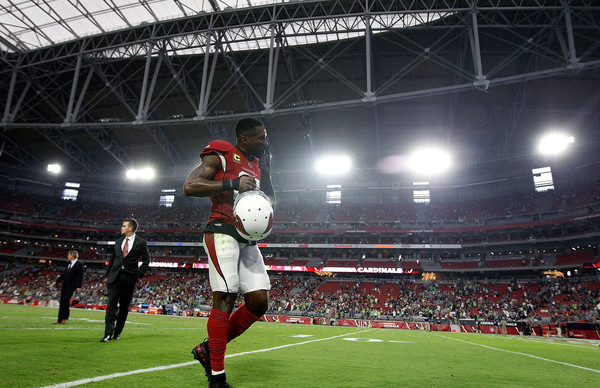 Arizona Cardinals cornerback Patrick Peterson walks off the field after a game with the Seattle Seahawks