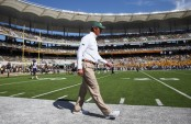 Former Baylor Bears head coach Art Briles walks the sideline before the second half against the West Virginia Mountaineers