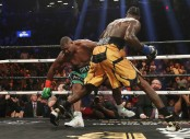 Boxer Deontay Wilder knocks down fellow boxer Luis Ortiz in the fifth round during their WBC Heavyweight Championship fight
