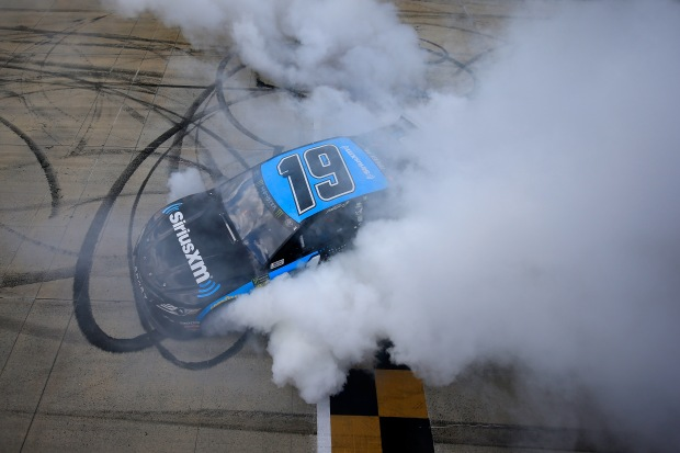 Driver Martin Truex Jr. does a burnout after winning the Monster Energy NASCAR Cup Series Gander RV 400