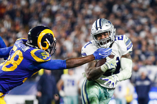 Dallas Cowboys running back Ezekiel Elliott is attempted to be tackled by Cory Littleton against the Los Angeles Rams