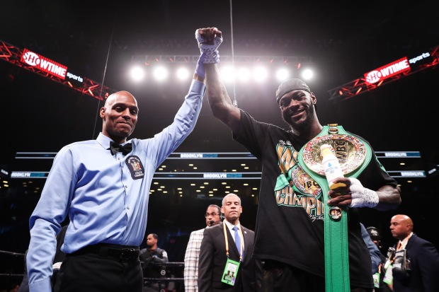 Boxer Deontay Wilder with his hand raised after making a statement against Dominic Breazeale
