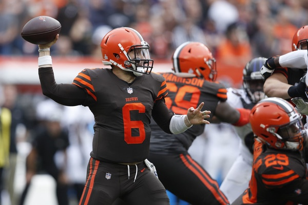 Cleveland Browns quarterback Baker Mayfield attempts a pass against the Baltimore Ravens