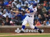 Chicago Cubs second basemen Ben Zobrist hitting a triple against the St. Louis Cardinals