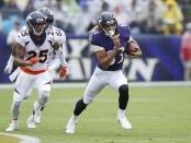 Denver Broncos cornerback Chris Harris Jr. attempts to tackle Willie Snead IV against the Baltimore Ravens